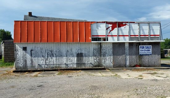 The owners of this dilapidated and unsafe former service station at 840 W. Main St. are being taken to court to clean up the property. (photo submitted)