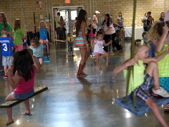 """Art swings were filled from 1 p.m. to midnight during the art exhibit opening """"Get in the Swing"""" which took place during Town Creek Live this past weekend. Swings are on-view, in operation and for sale by silent auction through Aug. 6, at the Wassenberg Art Center. (Photo submitted.)"""