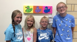 """Winners of the """"Get in the Swing"""" art competition at the Wassenberg Art Center during Town Creek Live was The Kopack Kids of Van Wert with their Ducky Warhol painted swing. They won $200 and will have their swing seasonally installed on the Wassenberg Art Center Grounds. (Photo submitted.)"""