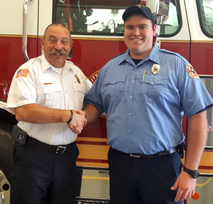 Van Wert Fire Chief Jim Steele (left) welcomes new Firefighter Dalton Yenser to the city fire department. (photo submitted)