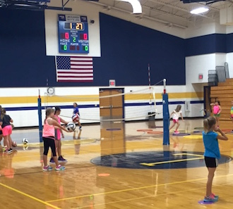 Kids enjoy volleyball as part of PE.  (Photo submitted.)