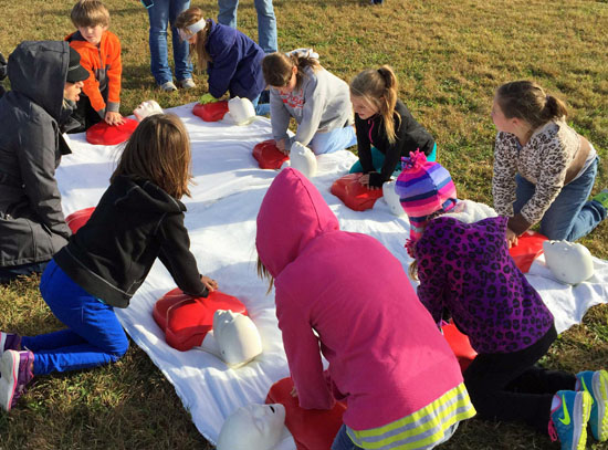 Van Wert Elementary School children learn CPR during a previous Kids Health Fair. (photo submitted)