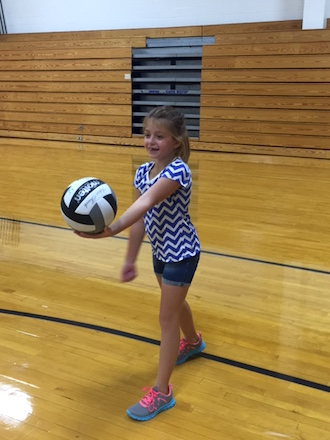 Pictured underhand serving is 3rd grader Sophia DeVecchio. (Photo submitted.)