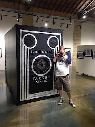Stephen Takacs photographs the Wassenberg Art Center during the Badlands and Brownies Exhibit at the Wassenberg Art Center, set to close Sept. 16. (Photograph by Scott Kraemer.)