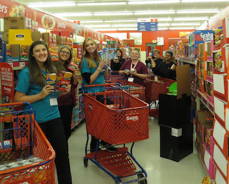 Vantage senior Medical Office Management students Shelby Wilhelm (Delphos St. John's), Jessica Smith (Van Wert), Alexie Bennett (Antwerp), Angela Fisher (Parkway), Tabitha Tennie (Van Wert), and Tasha Shull (Antwerp) and their teacher, Diane Font, show off their grocery items while shopping for the Day of Caring Food Drive. (Photo submitted.)
