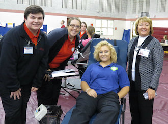 Vantage senior Health Technology students Ray Escobedo (Paulding) and Gracie Lammers (Lincolnview) join Culinary Arts senior Paige Gibbs (Continental) and their teacher, Wendy Baumle, at the Day of Caring Blood Drive.  (Photo submitted.)