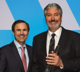 Central's Sr. Vice President of Information Technology John White (right) accepts the Pinnacle Award from Reid French, CEO of Applied Systems. (photo submitted)