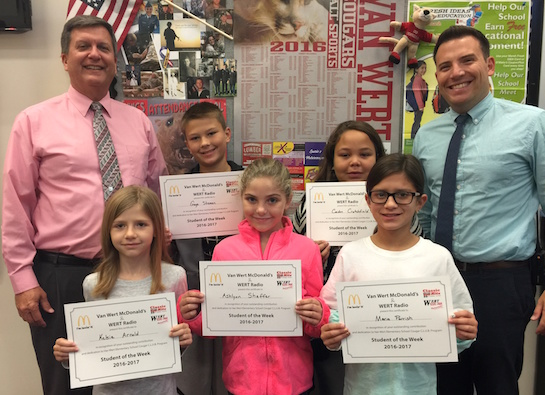 Congratulations to the Van Wert Elementary School Students chosen for the Word of the Week award! Pictured with Mr. Gehres, Principal, and Mr. Krogman, Assistant Principal, are students recognized for working hard. Award winners this week are Ashlynn, grade 1; Kelsie, grade 2; Maria, grade 3; Caiden, grade 4; and Gage, grade 5. Each child received a free Mighty Kids Meal from our local McDonalds and a certificate from WERT Radio. (Photo submitted.)