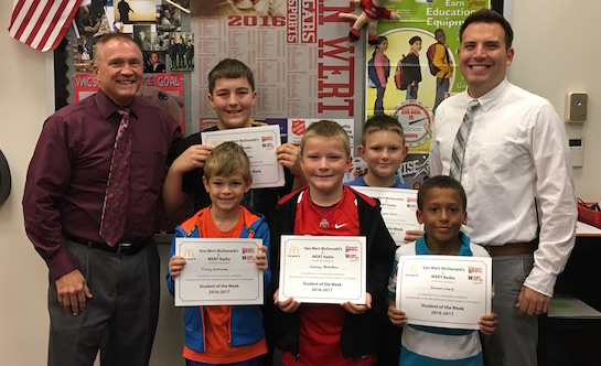 """Congratulations to the Van Wert Elementary Word of the Week Winners. Pictured with Ken Amstutz, Van Wert City Schools Superintendent (left) and Justin Krogman, Van Wert Elementary Assistant Principal, are students recognized for their """"Commitment"""". Pictured are James, Grade 5; Hayden, Grade 4; Daveon, Grade 3; Andrew, Grade 2; and Finley, Grade 1. Each child received a free Mighty Kids Meal from our local McDonalds and a certificate from WERT Radio. (Photo submitted.)"""