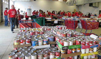 Students and adult volunteers working at the Day of Caring Food Drive inside the Vantage bus barn. (Photo submitted.)