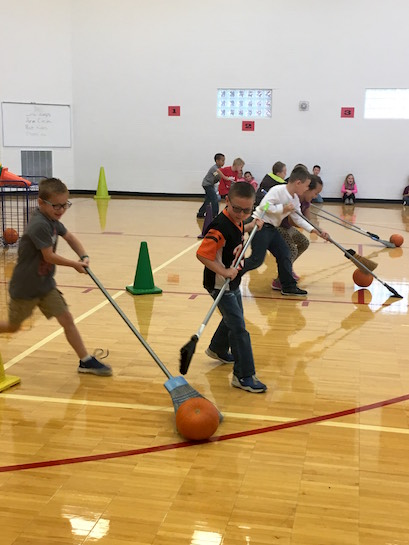 The first grade students participated in a walking rewards program last Friday. All the students have worked hard each morning by walking to start their day. At the rewards program they were challenged to roll pumpkins across the gym floor into a basket using only brooms. It was a great way to celebrate their dedication to fitness!  (Photo submitted.)