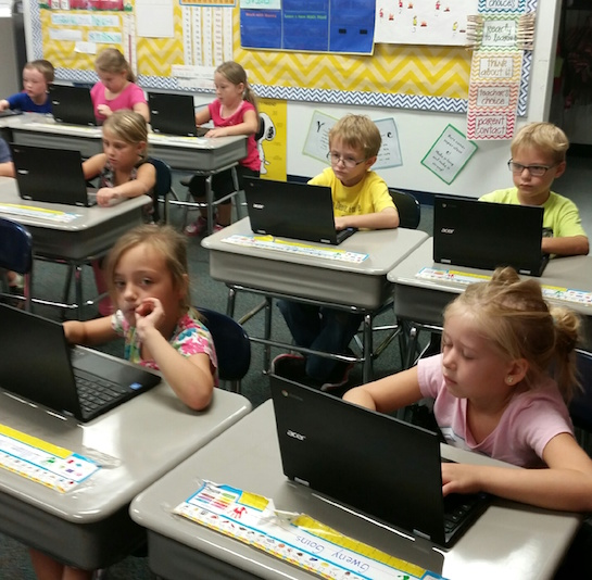 First graders in Mrs. Tow's class enjoy keyboarding class on their new Chromebooks.  Shown in the picture are: Lillian Young, Gweny Goins, Ainsley Hoffman, Logan Taylor, Emmett Behrens, Pacey Early, Janessa Fair and Kortni Hall.  (Photo submitted.)