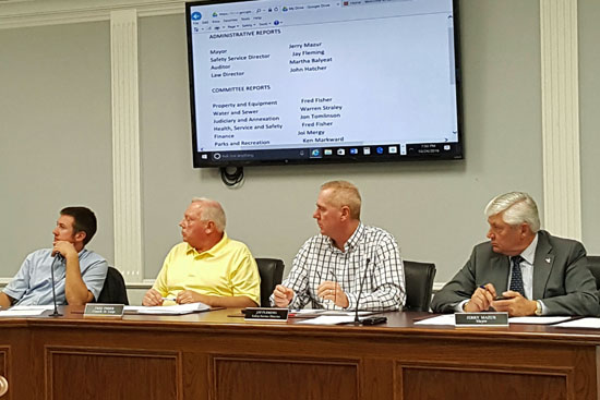 Councilmen At-Large Warren Straley (left) and Fred Fisher, listen to a statement by colleague Jon Tomlinson, while Mayor Jerry Mazur (right) and Safety-Service Director Jay Fleming also listen. Scott Truxell/Van Wert independent