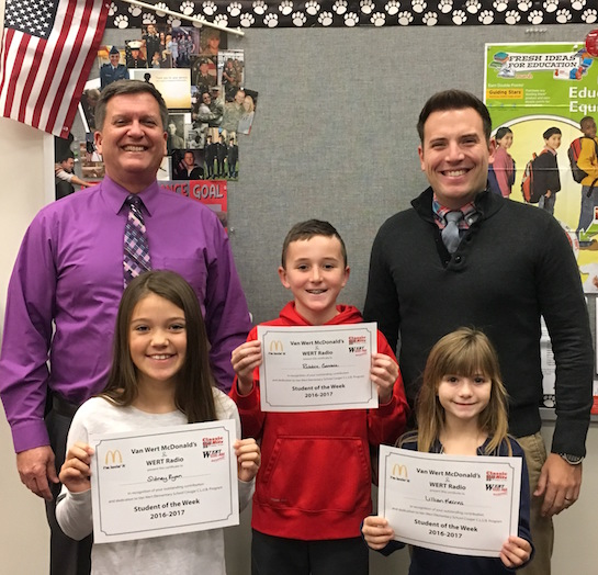 """""""Forgiving"""" is the Van Wert Elementary School Word of the Week!  Congratulations to the Van Wert Elementary School Students chosen for the Word of the Week award!  Pictured with Mr. Gehres, Principal, and Mr. Krogman, Assistant Principal are Lillian, grade 2; Sidney, grade 3; and Robbie, grade 4. Each child received a free Mighty Kids Meal from our local McDonalds and a certificate from WERT Radio. (Photo submitted.)"""
