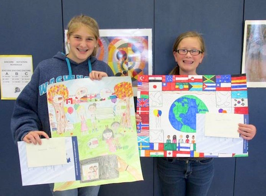 "These sixth grade Lincolnview students participated in the Lions International Peace Post Contest. This contest is held every year and encourages children 11-13, to creatively express what peace means to them. The 2016-2017 contest theme was ""A Celebration of Peace.""  Morgan Anspach placed first and Cheyenne Pohlman placed second at the local level. The first place winner's artwork will move on to be judged at the district level.  (Photo submitted.)"
