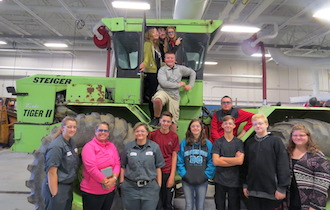 Van Wert eighth graders have fun on a tractor in the Ag and Industrial Power Tech lab during eigth grade tours this week. (Photo submitted.)