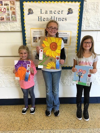 These three Lancer students were winners at the Apple Festival Art Show in Van Wert on October 21. Winners included second grader Josie Miller (1st place), sixth grader Autumn Springer (1st place) and fourth grader Ella Davis (3rd place). (Photo submitted.)