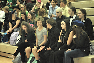 "A group of junior girls won the ""best group"" category during the Halloween costume contest with their Addams Family outfits. (Photo by M. Tracey.)"