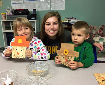 Erin Miller helps students with crafts. (photo submitted)