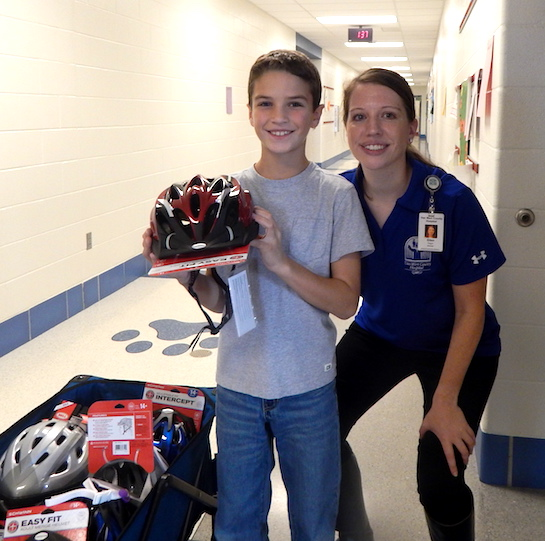 Van Wert County Hospital sponsored the annual Health Fair for the Van Wert Elementary School earlier this fall and followed up with a short quiz for each student.  The student with the highest score in each classroom received a free bike helmet from the hospital.  (Photo submitted.)