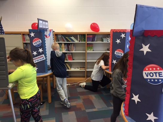Van Wert Elementary School students are voting on the Buckeye Book Award this week during library class. Over the past few weeks, students have heard five different book nominations in their age category. This week, students will vote for the one that they think should win the statewide award. Thanks to the Van Wert Board of Elections, students get to use a real voting booth as well as get a sticker when they complete their vote.  (Photo submitted.)