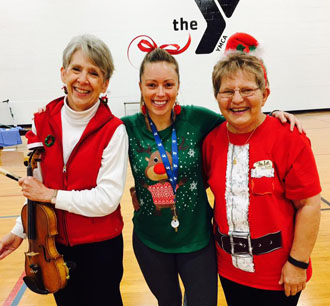 Shown are (from the left) Cindy Gardner, who generously provided live music, Kelly Houg, SilverSneakers extraordinaire, and Diane Haller, YMCA member. (YMCA photo)