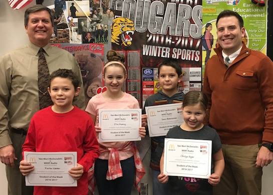 Congratulations to the Van Wert Elementary School Students chosen for the Word of the Week award!  Pictured with Mr. Gehres, Principal, and Mr. Krogman, Assistant Principal, are students recognized for showing good sportsmanship by playing fair and being gracious in winning and in losing.  Award winners this week are Jocilyn, grade 1; Gavin, grade 2; Ricky, grade 3 (not pictured); Karter, grade 4; and Ellie, grade 5.  Each child received a free Mighty Kids Meal from our local McDonalds, a free taco from our local Taco Bell, and a certificate from WERT Radio. (Photo submitted.)