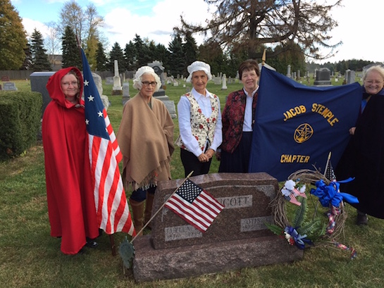 On November 11, 2016, members of the Jacob Stemple Chapter Daughters of the War of 1812 attended a rededication ceremony at the Rockport Methodist Cemetery, Allen County, to honor Jacob Stemple Chapter founder, Luella May (Smith) Lippincott 1876-1959.  Lippincott was descended through her mother Elizabeth Ann (Stemple) Smith to Jacob Stemple, who was a native of Virginia, born in 1792. Jacob  served in the war of 1812, under Gen. Harrison, and was captain of early militia companies of Carroll and Columbiana Counties. He had moved from Virginia in 1816; was also a justice of the peace several years. . He died in 1859. Luella Smith Lippincott founded the Jacob Stemple Chapter Daughters of the War of 1812 in 1952. January 8 was the Quasquicentennial of the National Society Daughters of the War of 1812 and March 27 will be the 65th Anniversary of the Jacob Stemple Chapter.  From the left: Kathy Foust, Joan Stripe, Gloria Fast, Miriam Fetters, and Esther Lyons.   (Photo submitted.)