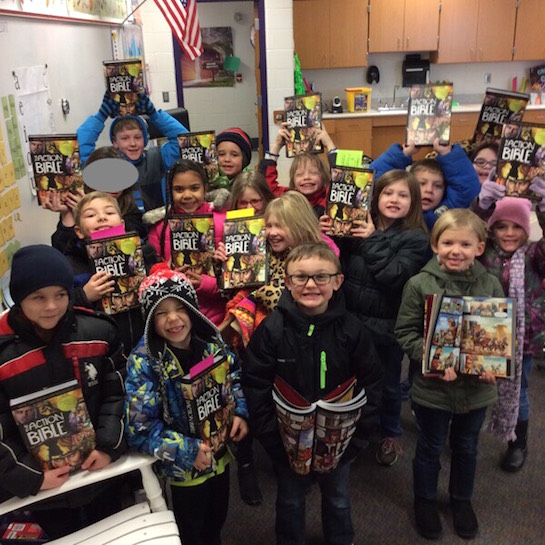 A copy of the Action Bible was given to first graders attending Cross Over the Hill.  (Photo submitted.)