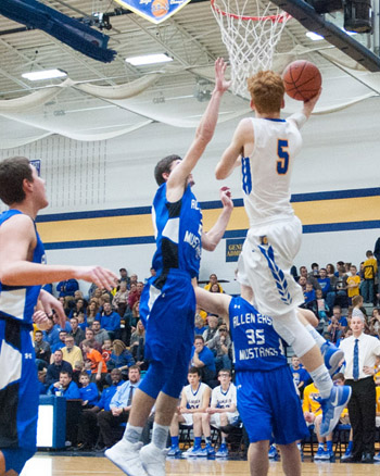 Lincolnview's Ryan Rager (5) puts in a reverse layup against Allen East in Friday's Lancer win. Bob Barnes/Van Wert independent