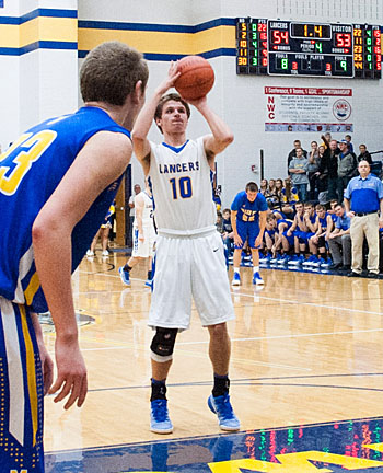 Lincolnview's Ethan Kemler (10) prepares to make the front end of a 1-and-1 to give the Lancers a 55-53 win over Miller City. Bob Barnes/Van Wert independent