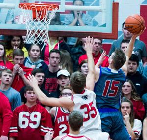 Crestview's Javin Etzler (15) puts a shot up while anxious Van Wert fans watch. Bob Barnes/Van Wert independent