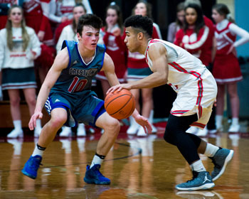 Crestview's Drew Kline (10) and Van Wert's Jacoby Kelly (5) face off in Saturday's non-conference rivalry game played at the S.F. Goedde Building. The Cougars rallied to beat the Knights 47-44. Bob Barnes/Van Wert independent