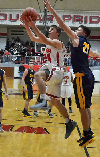 Cougar Dylan Lautzenheiser (24) put in a layup during Van Wert's heartbreaking loss to Ottawa-Glandorf. Jan Dunlap/Van Wert independent