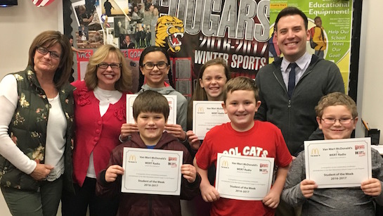 Congratulations to the Van Wert Elementary School Students chosen for the Word of the Week award! Mr. Krogman, Assistant Principal, Mrs. Anderson and Mrs. Hammond, School Secretaries, are pictured with students recognized for being helpful.  Award winners this week are Kasyn, grade 1; Jude, grade 2; Mason, grade 3; Kenlie, grade 4; and Jordanne, grade 5.  Each child received a free Mighty Kids Meal from our local McDonalds, a free taco from our local Taco Bell, and a certificate from WERT Radio. (Photo submitted.)