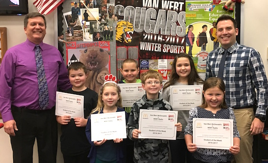 Congratulations to the Van Wert Elementary School Students chosen for the Word of the Week award!  Pictured with Mr. Gehres, Principal, and Mr. Krogman, Assistant Principal, are students recognized for showing initiative by being self-motivated, resourceful and ambitious.  Award winners this week are Stella and Jocilyn, grade 1; Korbyn, grade 2; Kole, grade 3; Gavin, grade 4; and Emma, grade 5.  Each child received a free Mighty Kids Meal from our local McDonalds, a free taco from our local Taco Bell, and a certificate from WERT Radio. (Photo submitted.)