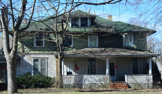 This derelict house at 421 N. Market St. will be one of the first structures demolished under a grant received by the county land bank entity. Dave Mosier/Van Wert independent