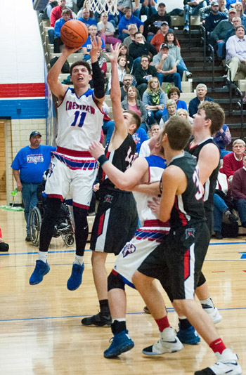 Crestview's Derek Stout (11) put up a shot at the basket during the Knights' Northwest Conference tilt Friday against Spencerville in Ray Etzler Gymnasium. Bob Barnes/Van Wert independent