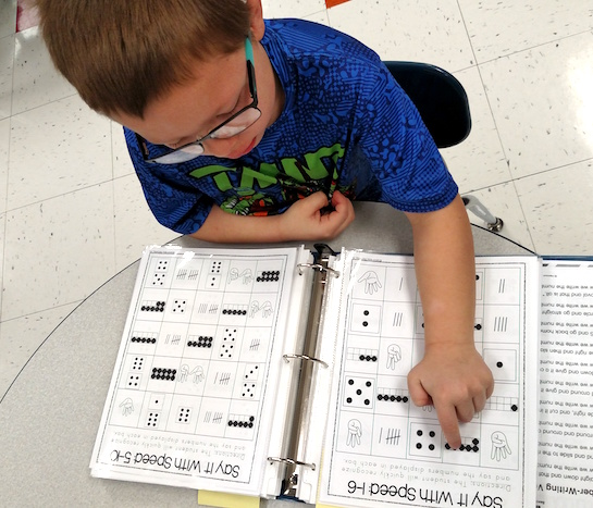 Students in Kindergarten practice recognizing numbers as fast as they can! They are looking at ten frames, fingers, tally marks and dice. (Photo submitted.)
