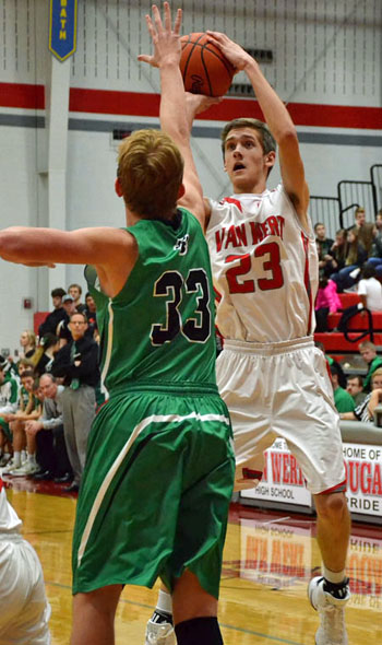 Van Wert's Blake Henry (23) shoots over a Celina defender during the two team's Western Buckeye League contest Friday in the Cougars' Den. Jan Dunlap/Van Wert independent