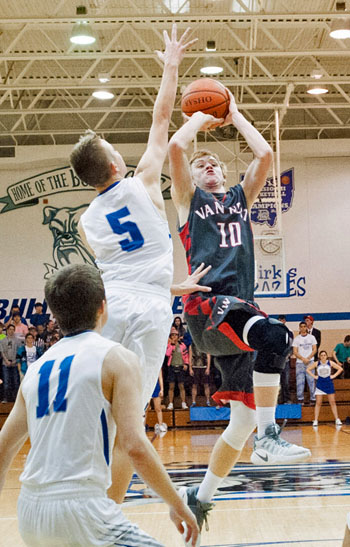 Van Wert's Nate Place (10) puts up a shot over a Defiance defender in a 49-48 Cougar win over the Bulldogs. Bob Barnes/Van Wert independent