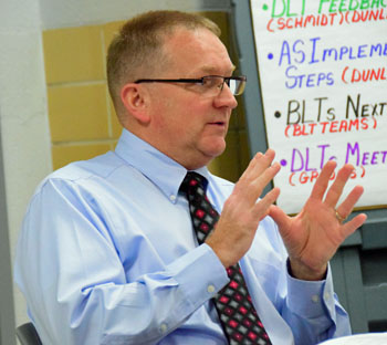 Van Wert City Schools Treasurer Mike Ruen talks about funding projections from Governor John Kasich's 2018-19 biennial budget during Wednesday's meeting of the district Board of Education. Dave Mosier/Van Wert independent