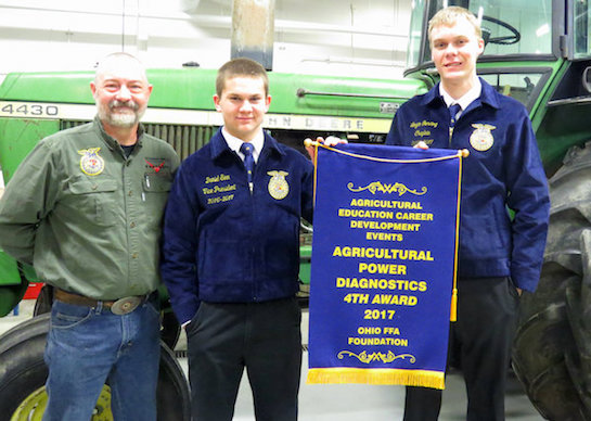 The Vantage FFA Agricultural Power Diagnostics team of Daniel Sinn (Wayne Trace) and Logan Gerding (Kalida) captured fourth place in the state competition that was held at UNOH on March 3.  They earned the right to compete by placing first in the District competition held in February.  They're pictured with their teacher, Mike Miller.  (Photo submitted.)