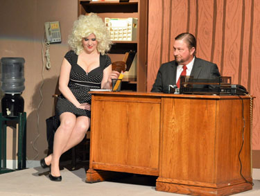 Doralee (Victoria Recker) takes dictation from boss Franklin Hart (Steve Lane) during Van Wert Civic Theatre's production of 9 to 5: The Musical. Monica Campbell/for the VW independent