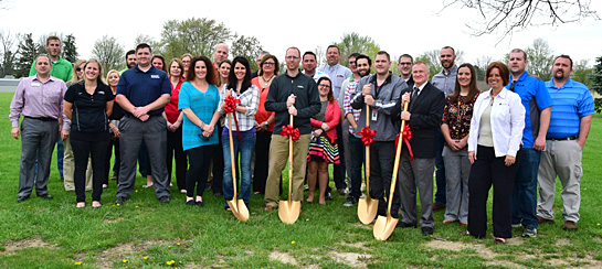 Van Wert County Leadership Class members, Chamber board members and staff, a Alexander & Bebout representative, and Van Wert City Superintendent of Schools Ken Amstutz break ground on a new bus shelter at the former Washington Elementary School site. Dave Mosier/Van Wert independent