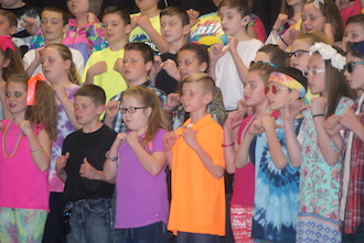 "Pictured are the fifth grade students singing ""Mountain Music"" from Rock the Jukebox by Mark Brymer. (Photo submitted.)"