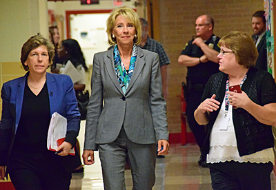 AFT President Randi Weingarten (left) and U.S. Education Secretary Betty DeVos (center) walk down a hallway at the VW ECC as Principal Lori Bittner explains some of the school's programs. Dave Mosier/Van Wert independent