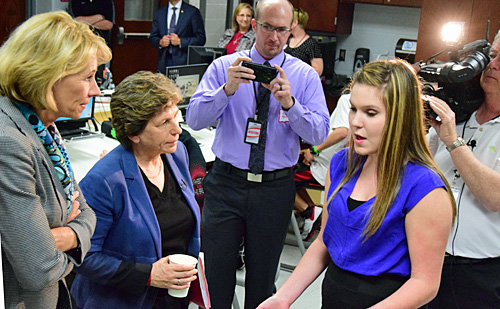 AFT President Randi Weingarten (left) and U.S. Secretary Betty DeVos (center) talk with VWHS freshman Alaina Arney, who is seeking a U.S. patent for a part she designed as an engineering class project. Dave Mosier/Van Wert independent
