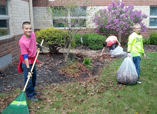 The Lincolnview sixth grade students participated in cleaning up the school grounds as part of their Earth Day project. (Photo submitted.)