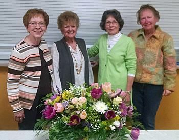 Evergreen Garden Club hostesses in April were (from the left) Bev Wolke, Sandra Brady, Kate DeVogel, and Carolyn Owens. (photo submitted)